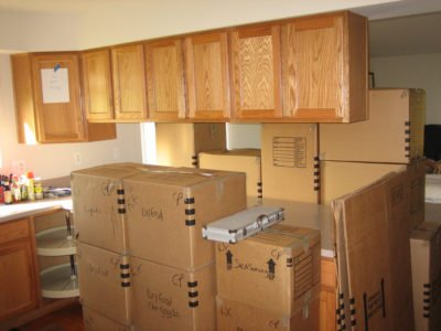 Photo of moving boxes sitting in a kitchen